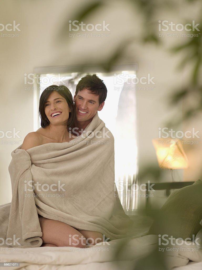 Boyfriend hugging girlfriend in bed royalty-free stock photo