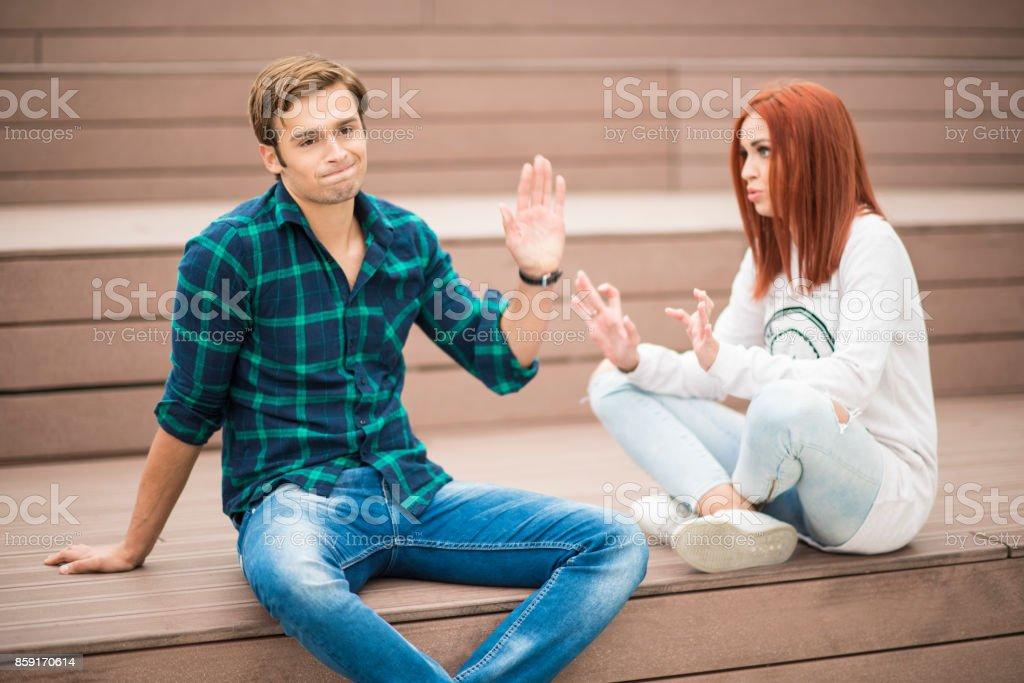 Boyfriend ignoring his girlfriend during an argument stock photo