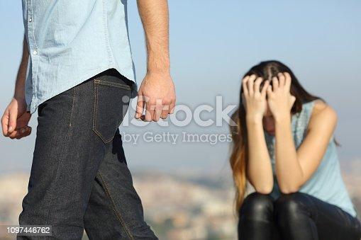 istock Boyfriend leaving his girlfriend after break up 1097446762