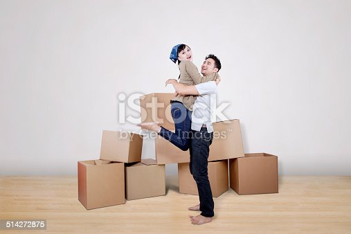 istock Boyfriend lift girlfriend at new home 514272875