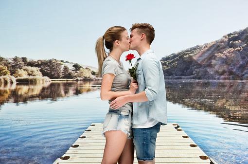 Boyfriend wearing t-shirt and holding single flower