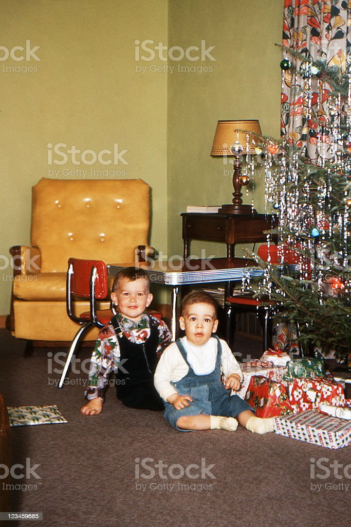 boys and Christmas tree in living room 1953, retro stock photo