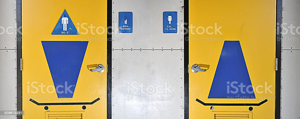 Boys And Girls Bathroom With Skateboard Symbols Stock Photo More