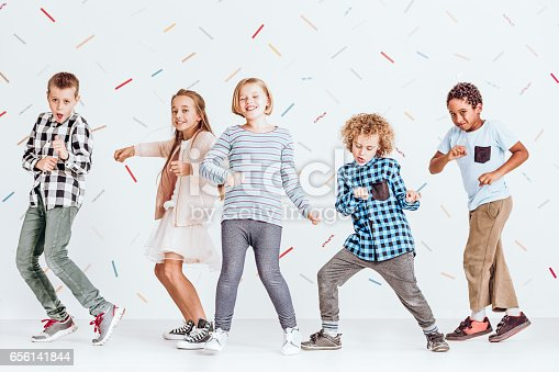istock Boys and girls dancing 656141844
