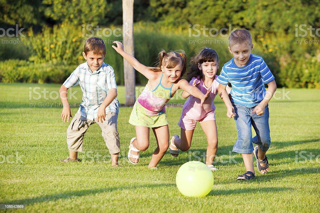 Boys and girls running stock photo