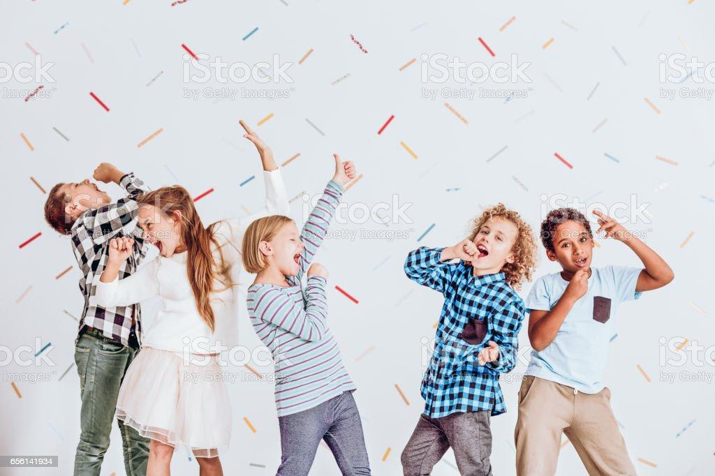 Boys and girls singing stock photo