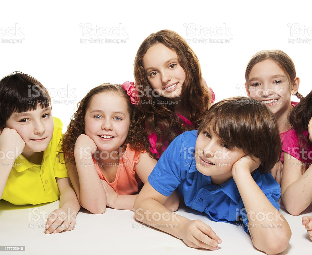 Boys and girls together on the floor royalty-free stock photo