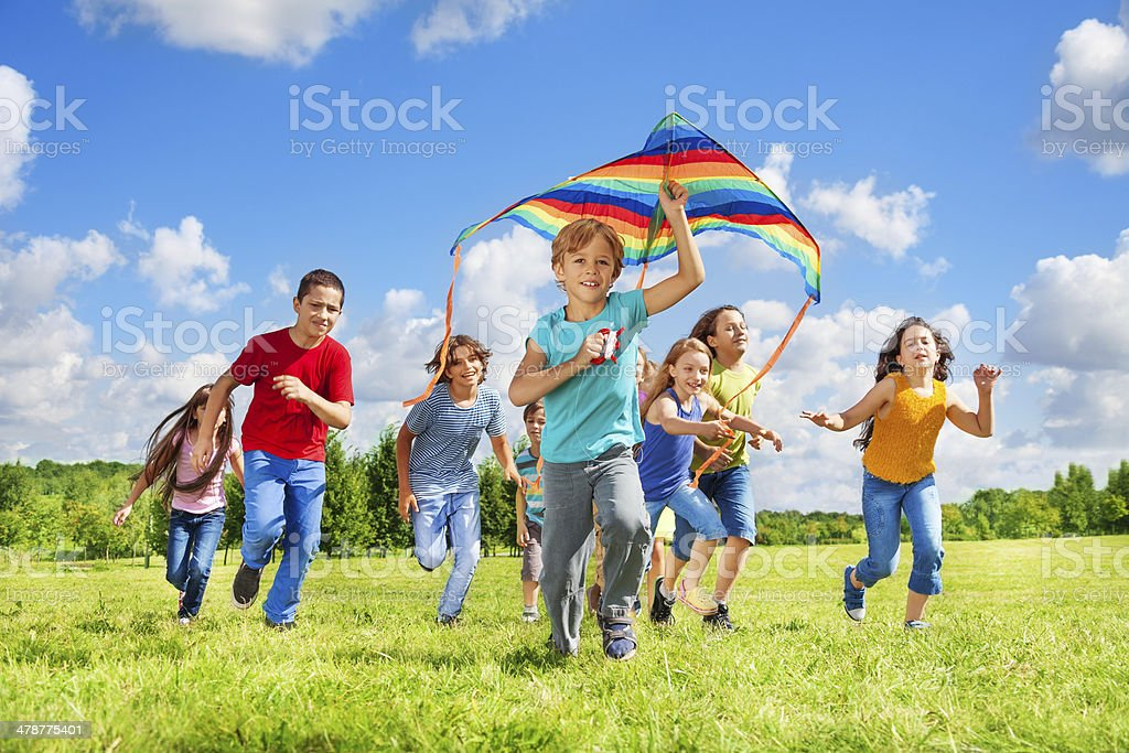 Boys and girls with kite stock photo