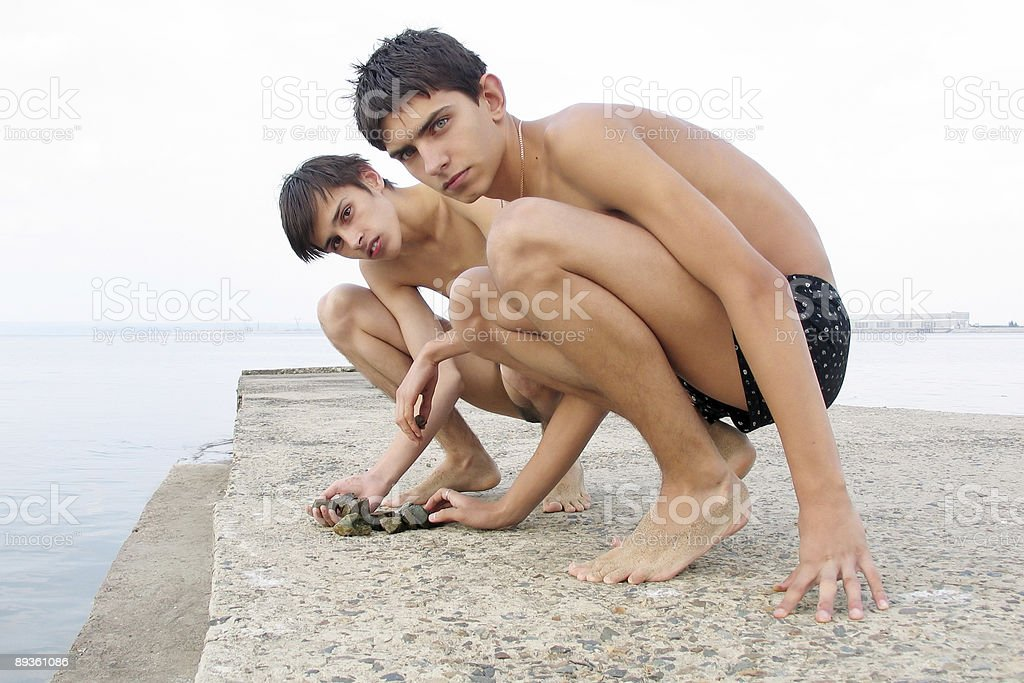 boys and stones royalty free stockfoto