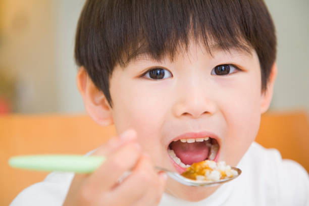 Boys are eating Curry and rice Boys are eating Curry and rice curry meal stock pictures, royalty-free photos & images