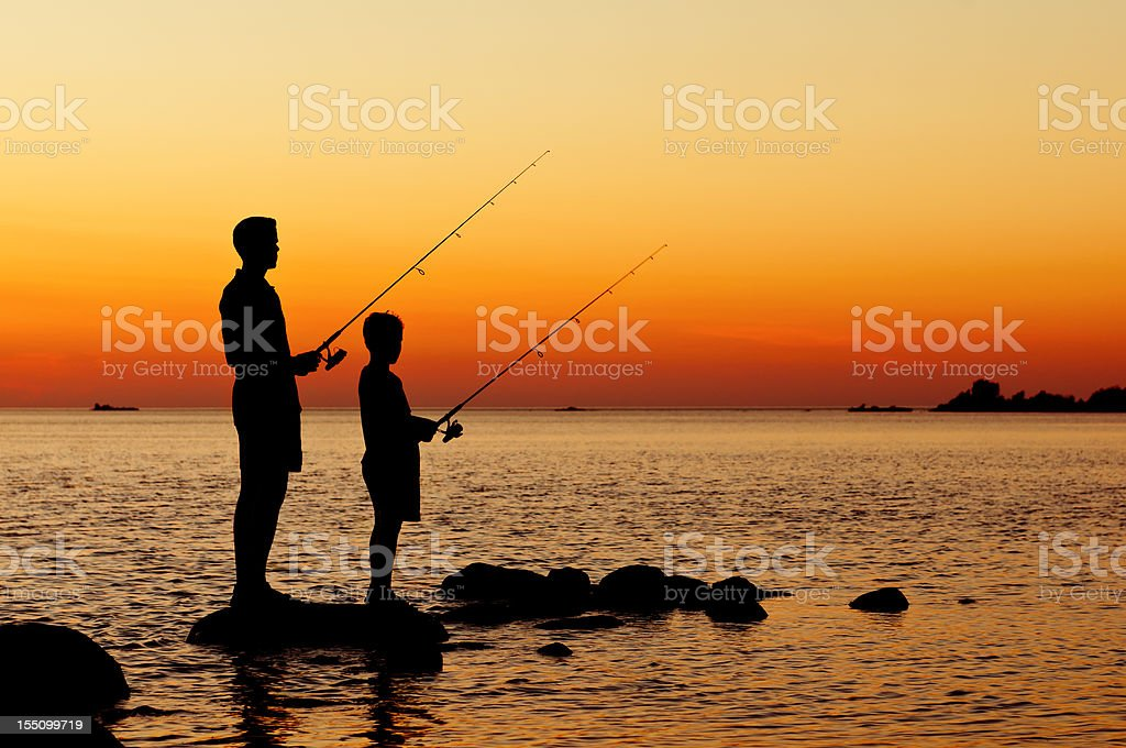 Boys Are Fishing At Sunset - IV royalty-free stock photo