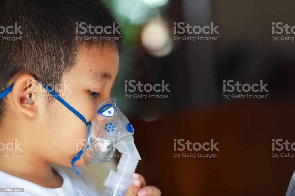 Boys are spraying allergy medication. stock photo