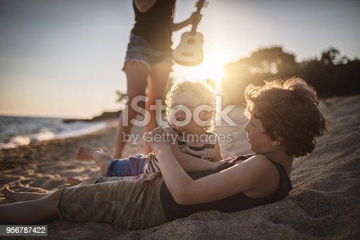 656711080 istock photo Boys at the beach 956787422
