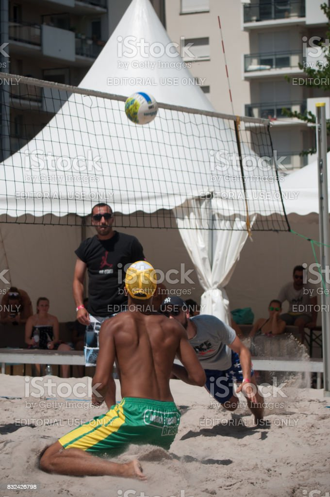 boys at the beach volley in the city during the summer vacation stock photo