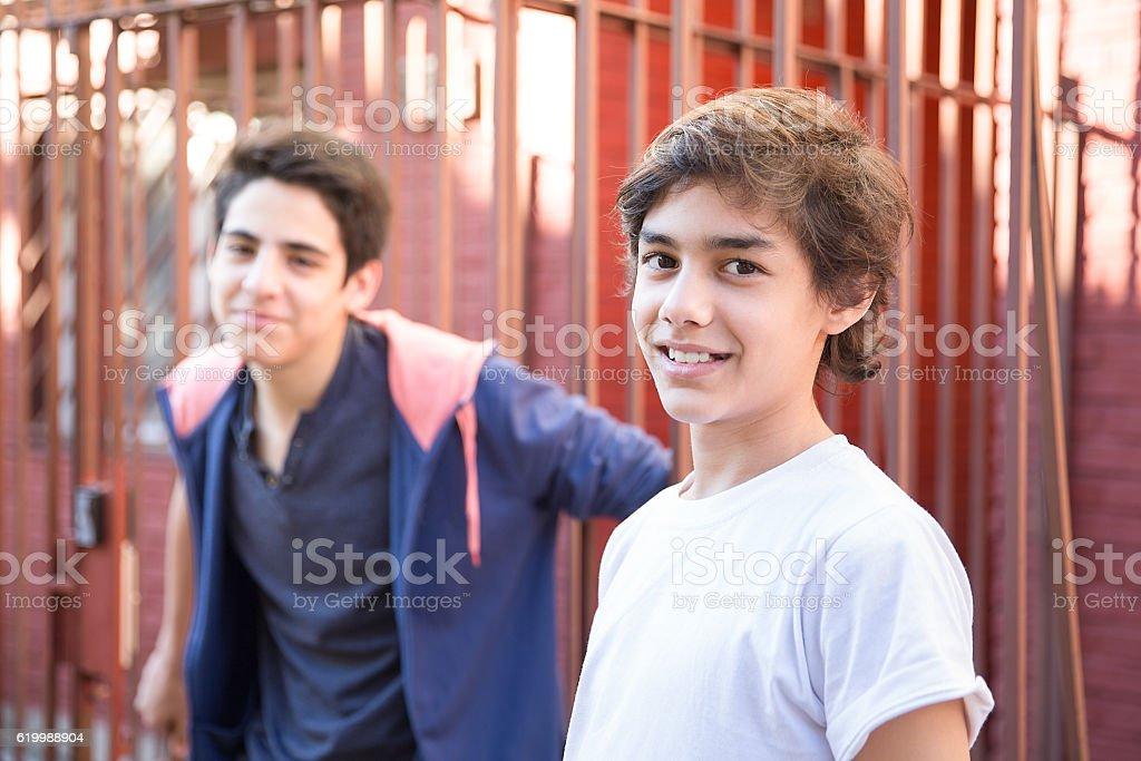 Boys Brothers Having Fun outside stock photo