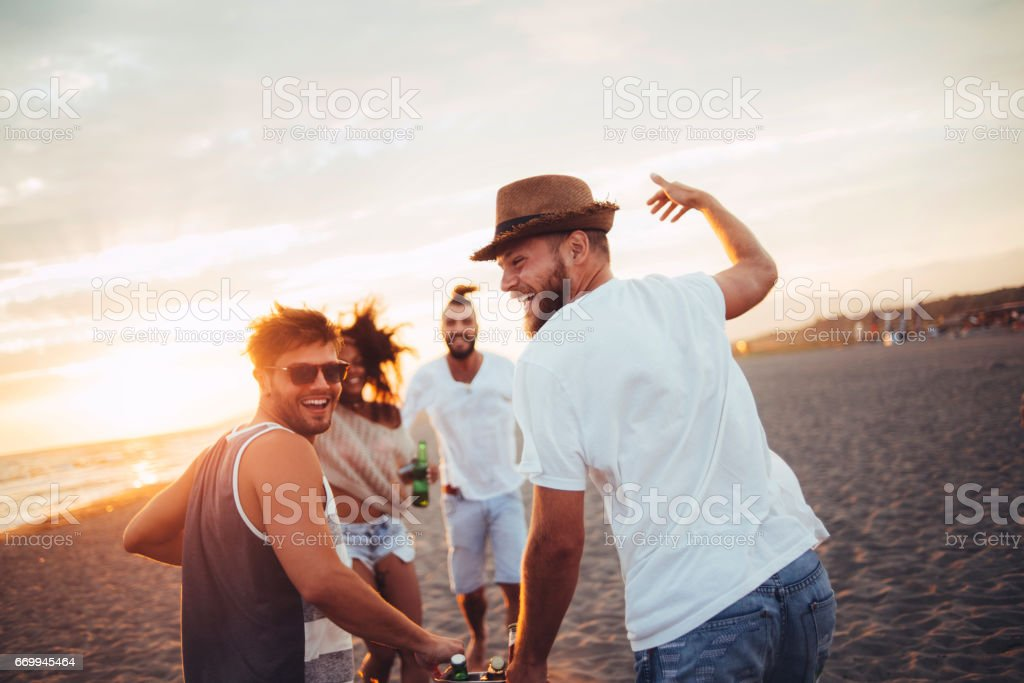 Boys carrying drinks stock photo