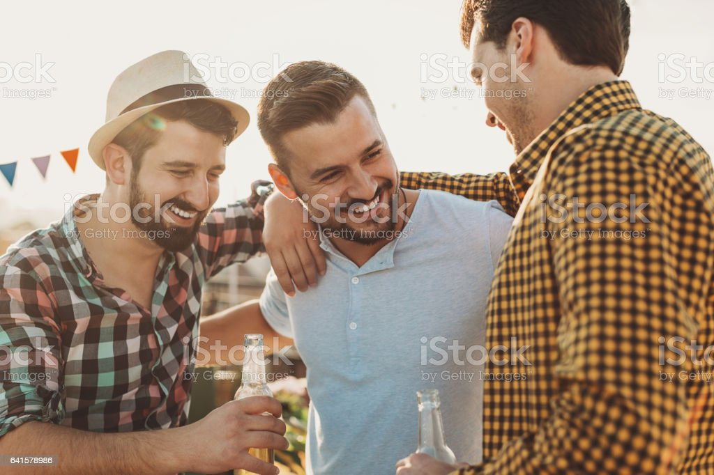 Boys chatting over beer stock photo