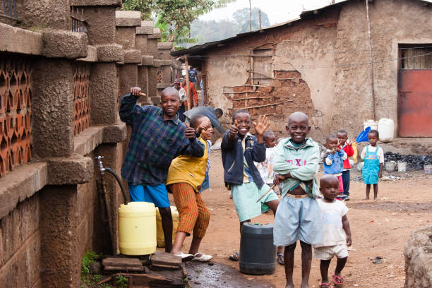 Boys Collecting Water in African Slum stock photo