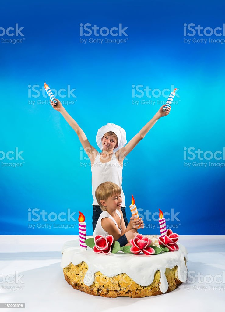 Boys decorate the cake stock photo