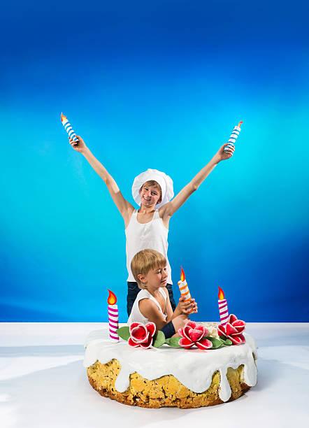 Boys decorate the cake stock photo