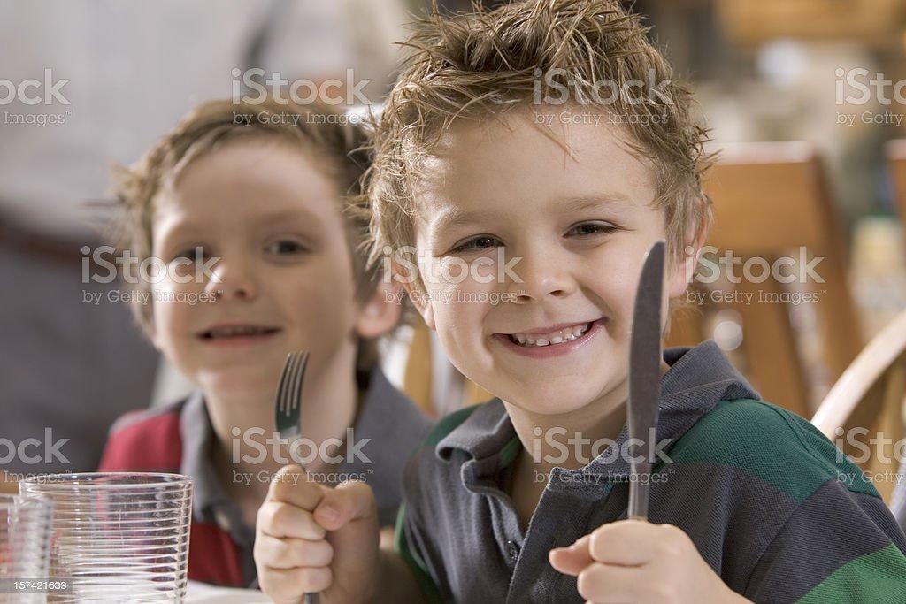 Boys- Dinner Table stock photo