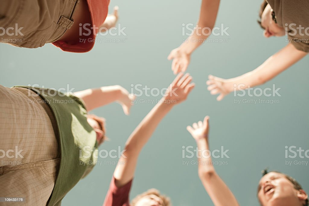 Boys doing high five, low angle view royalty-free stock photo