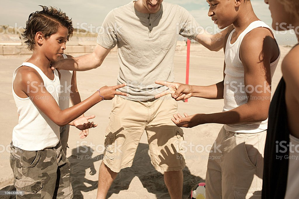 Boys doing rock, paper, scissors stock photo