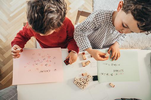 Boys drawing at home