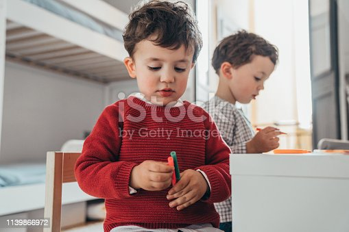 983418152istockphoto Boys drawing at home 1139866972