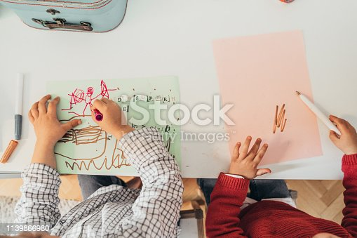 983418152istockphoto Boys drawing at home 1139866980