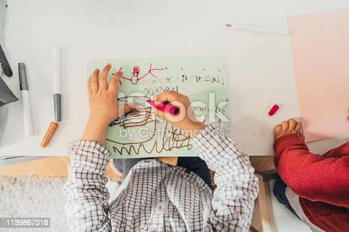 983418152istockphoto Boys drawing at home 1139867018