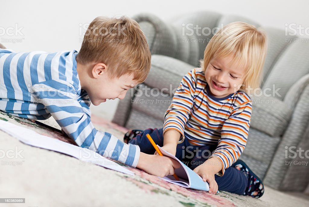 Boys drawing in the notepad royalty-free stock photo