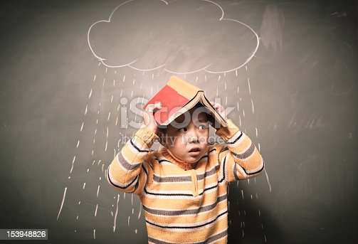 one asian little boy images raining