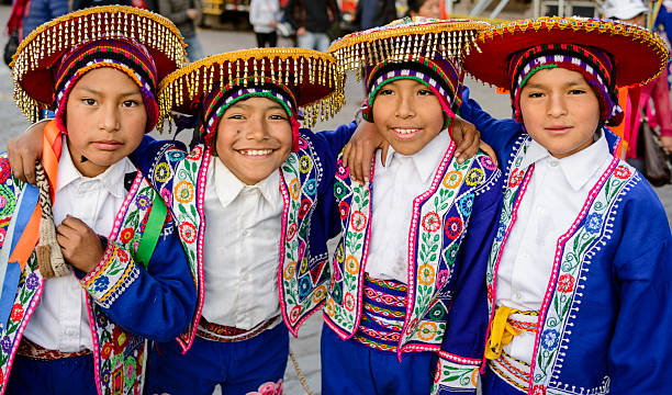 Boys dressed in traditional Peruvian costumes Lima, Peru - June 17, 2016: Young boys dressed in traditional colorful  folkloric costumes.  They are waiting to perform traditional dances in parade during a religious festival. peruvian culture stock pictures, royalty-free photos & images