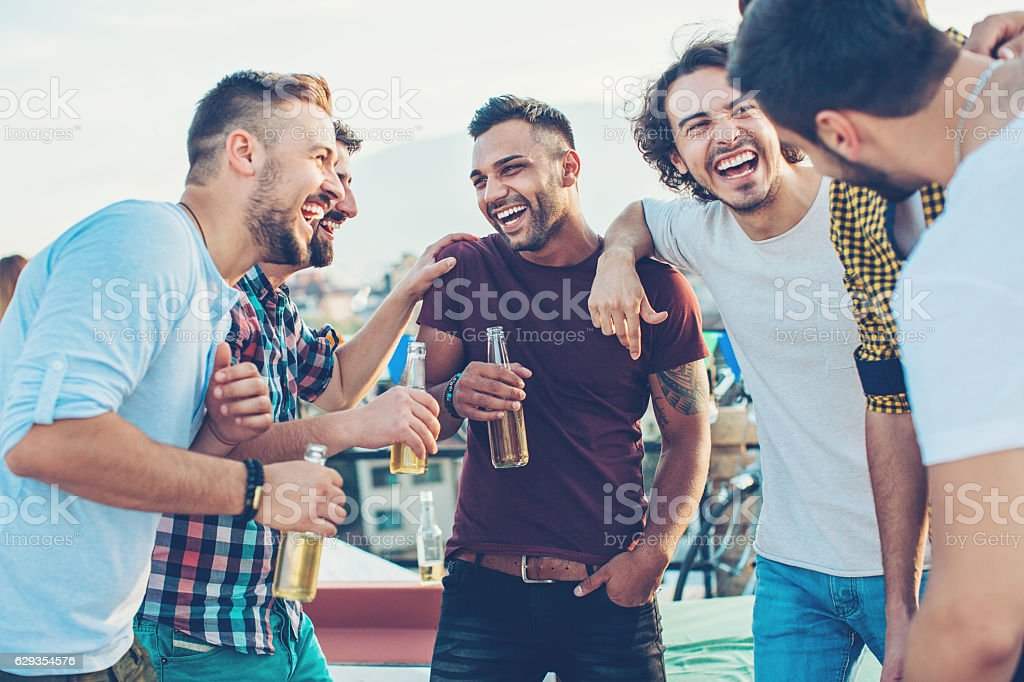 Boys drinking beer and having fun