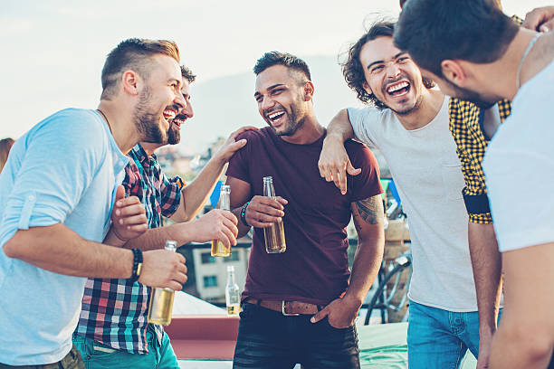 Boys drinking beer and having fun stock photo