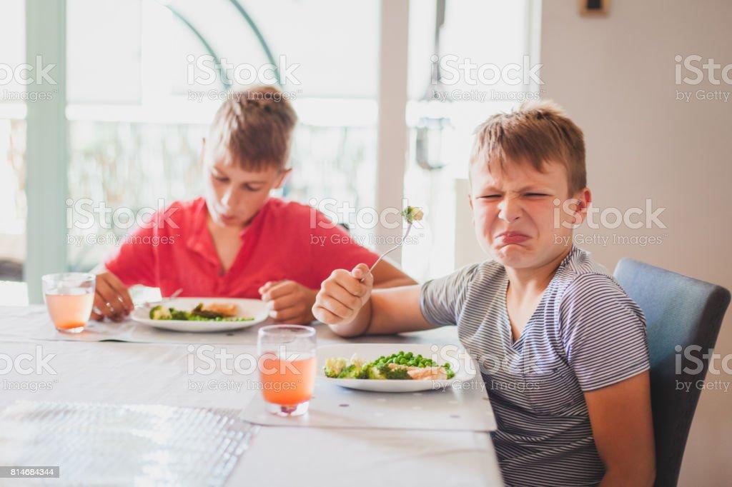 Boys Eating Dinner stock photo
