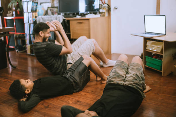 Boys Exercise With Dad Using Streaming Video