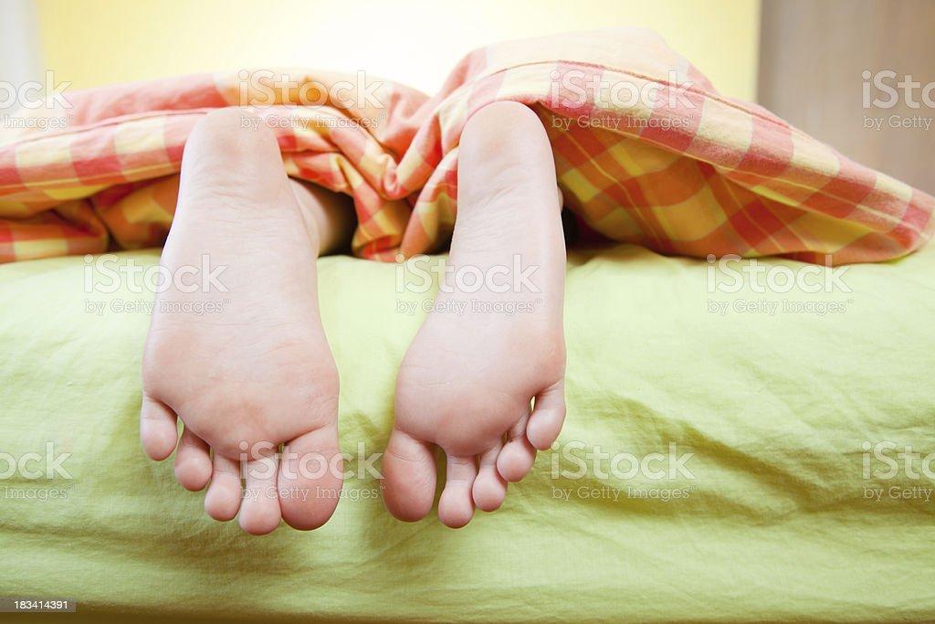 boyu0027s feet in bed royaltyfree stock photo