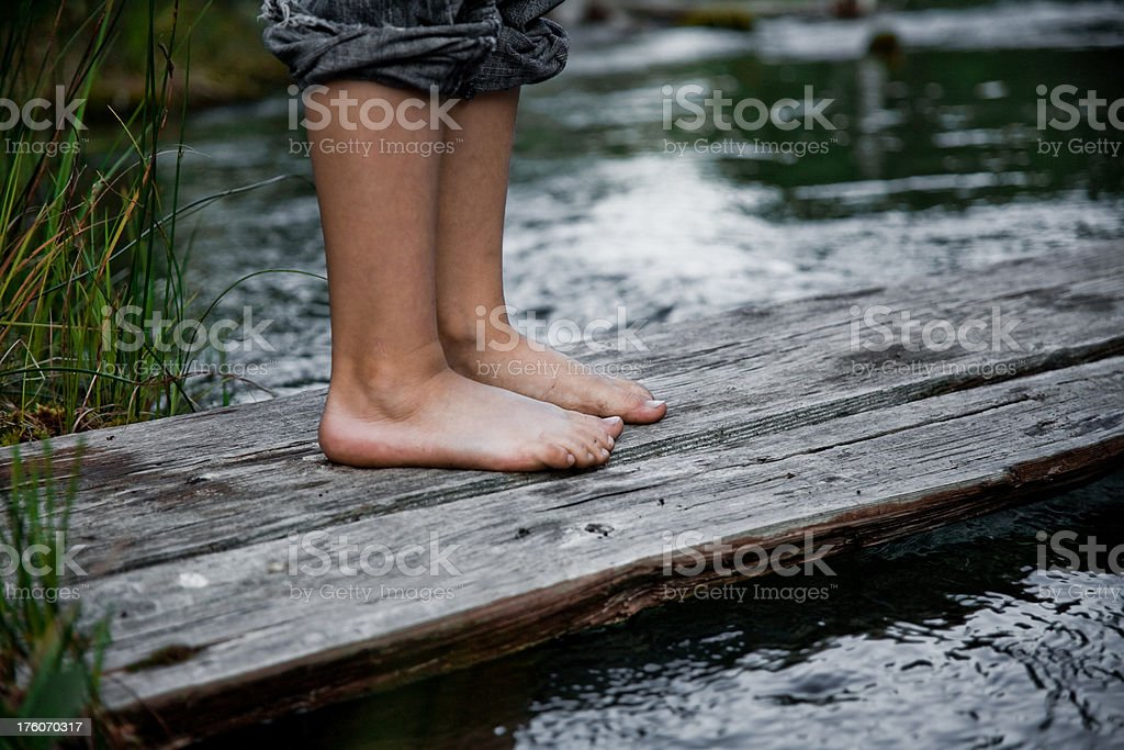 Boys Feet On A Bridge Royalty Free Stock Photo