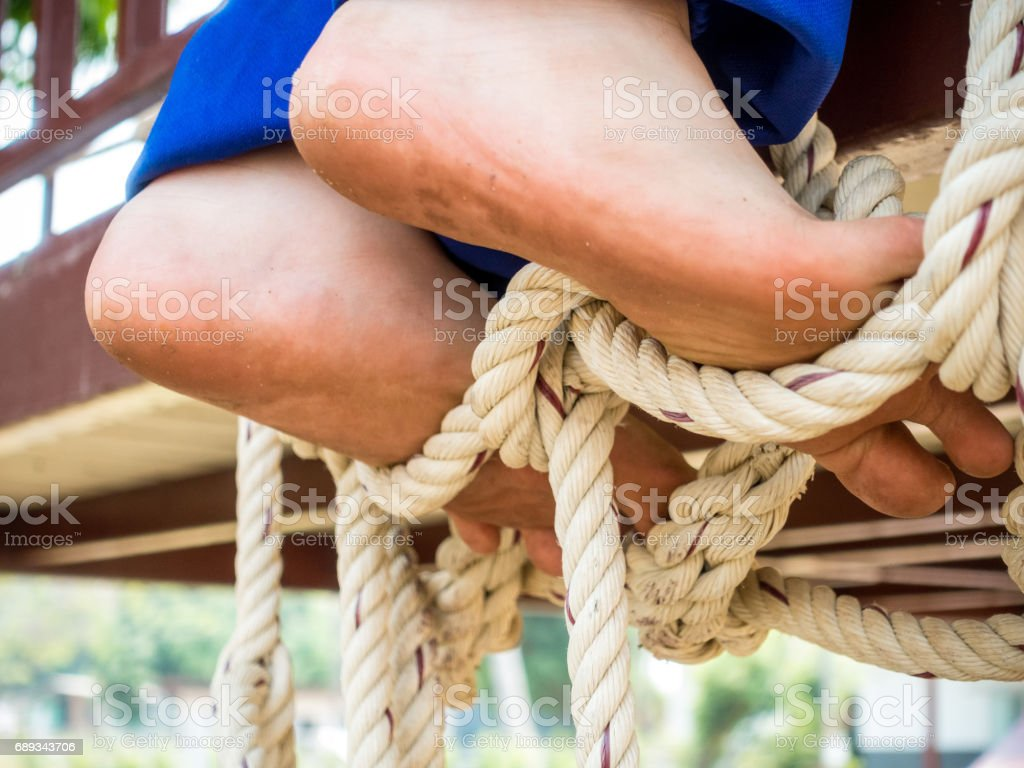 Boys Feet Step On A Rope At Playground Royalty Free Stock Photo