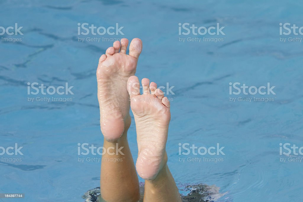 Boys Feet Sticking Out Of Water While Swimming In Pool Stock Image