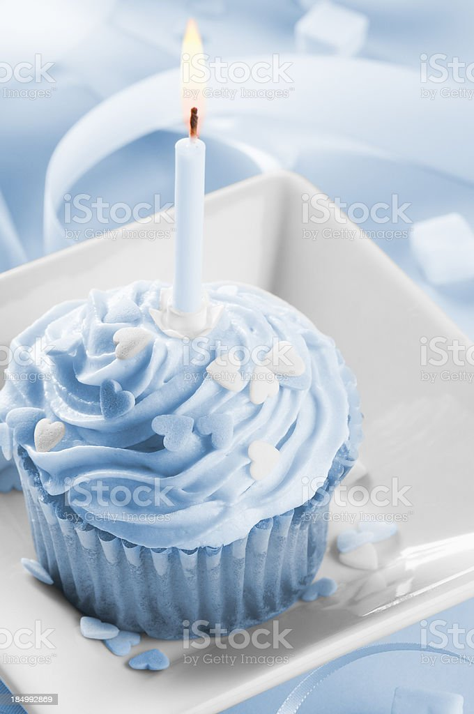 Pleasing Boys First Birthday Cake With Candle Blue Icing And Ribbon Stock Personalised Birthday Cards Bromeletsinfo