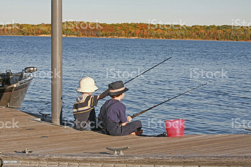 Boys Fishing in the Autumn royalty-free stock photo