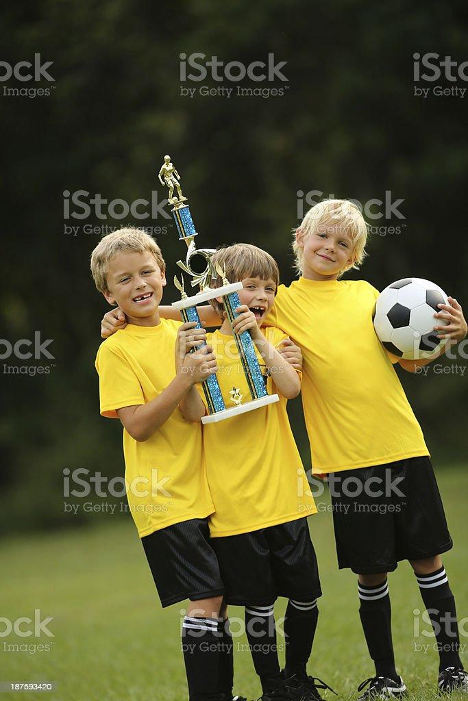 Boys Football Team Holding Trophy royalty-free stock photo