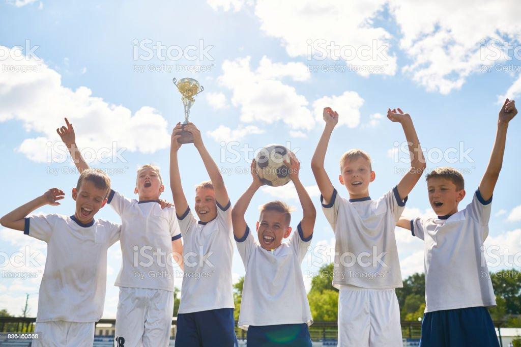 Boys Football Team Winning Champions Cup stock photo