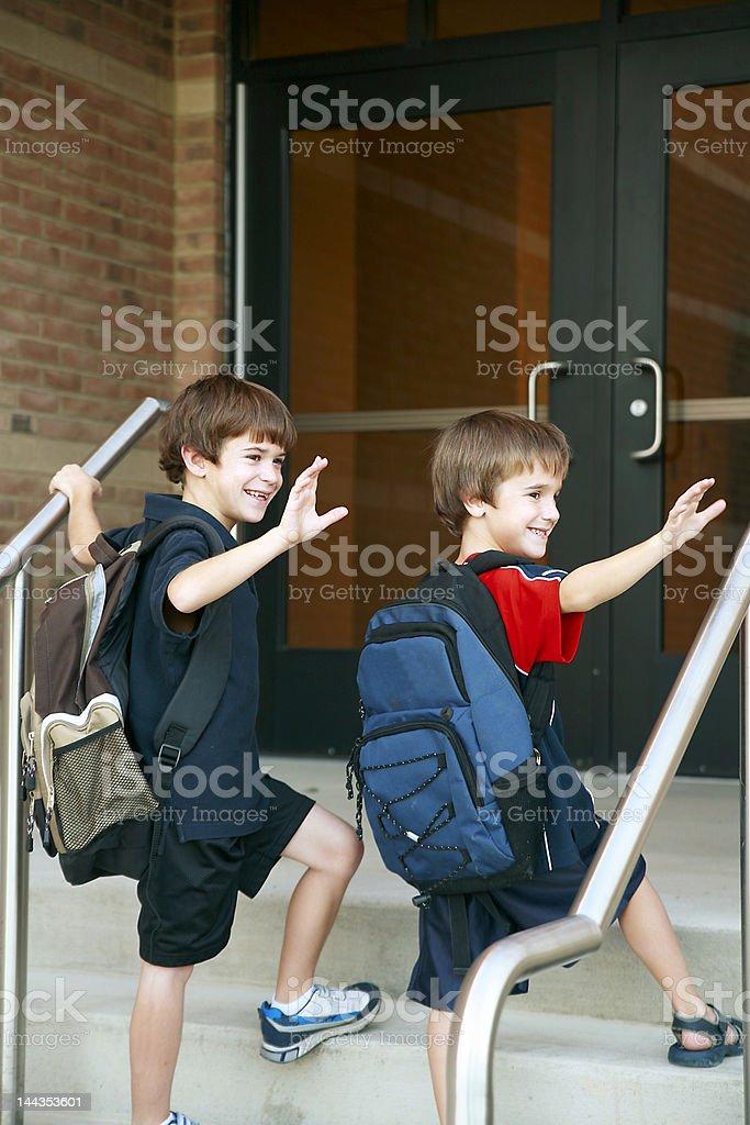 Boys Going into School stock photo