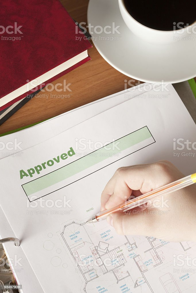 Boy's hand correct final drawing design stock photo
