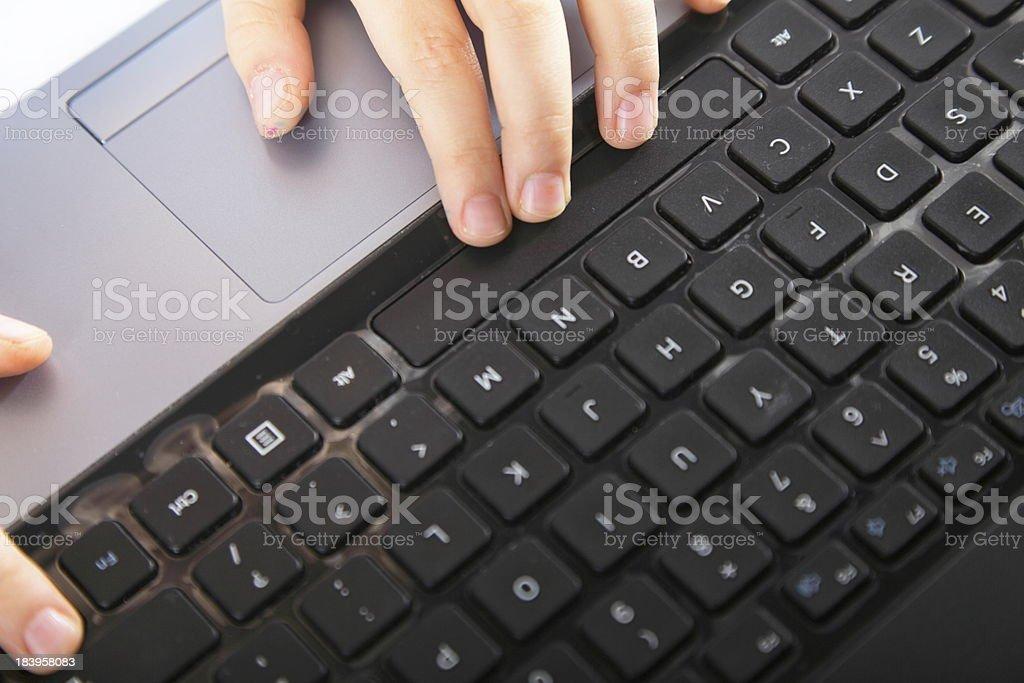 boy's hand typing on laptop keyboard royalty-free stock photo