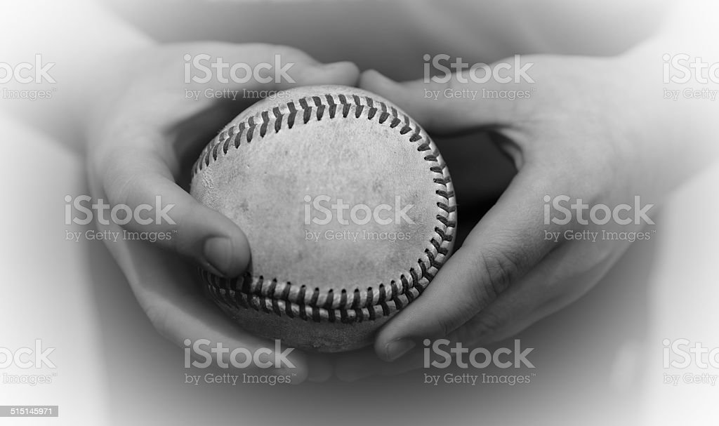 Boy's hands holding a Baseball stock photo